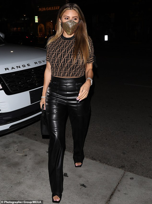 On the go:The 46-year-old estranged wife of Scottie Pippen was stylish as ever in a tight Fendi top and a pair of black leather trousers
