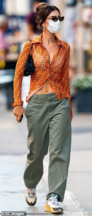 Baggy fit: They sat just below her navel with a baggy fit