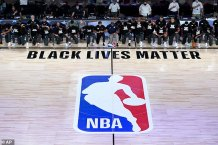 NBA players, coaches and refs ALL kneel in protest of racism during the national anthem as the league re-opens in the Disney bubble 141 days after halting play due to the pandemic