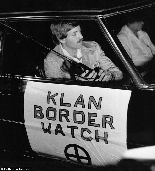 Duke led the KKK from 1974 to 1978 before he rebranded himself as a born-again Christian to run for Congress. Pictured: Duke patrols the California-Mexico border for illegal immigrants in a 'Klan Border Watch' automobile, date unknown
