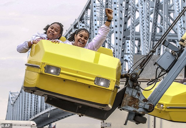 Residents enjoy the Hurricane Ride at the 41st Annual International Bar-B-Q Festival last year