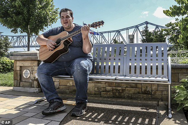 "Alex Martin plays the song ""Can't You See"" by The Marshall Tucker Band on his Takemine acoustic guitar while enjoying the outdoors at Owensboro's Smothers Park on July 1"