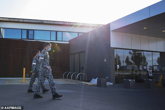 Military personnel patrol the Epping Gardens elderly care facility in Epping, Melbourne