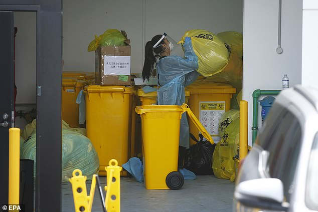 State Health Director Brett Sutton has confirmed that a New Zealand-style lockdown, which has seen all businesses except essential services closed, is being explored (pictured , clinical waste is disposed of at Epping Gardens Elderly Care Center in Epping, Melbourne)