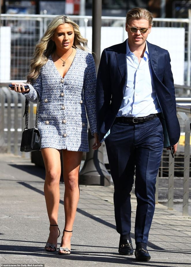 The pair arrived arm-in-arm (pictured) atSydney's Otto Ristorante in Woolloomooloo on Saturday afternoon