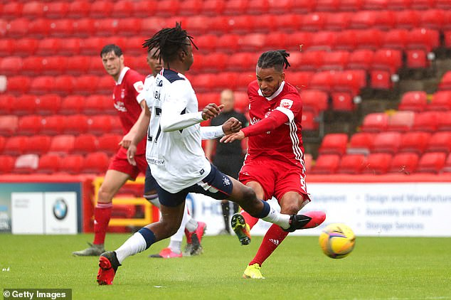 Chances were tight for Aberdeen with Funso Ojo (right) trying his luck