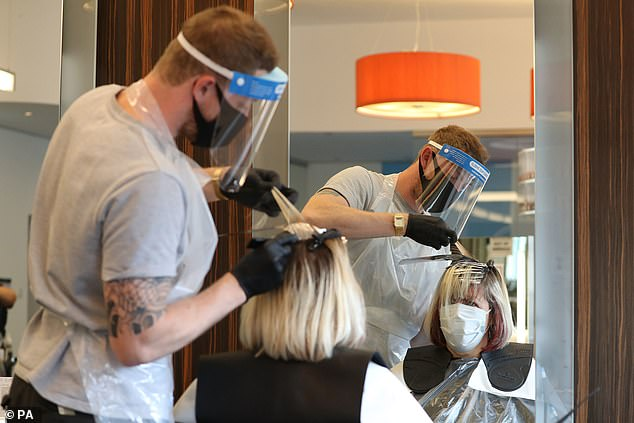 Ministers face calls from scientists asking barbers and hairdressers to use face masks or masks (pictured) when wearing visors