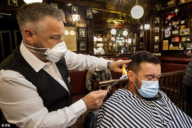 In the UK, it is currently not mandatory for hairdressers or barbers to wear additional personal protective equipment other than a visor.