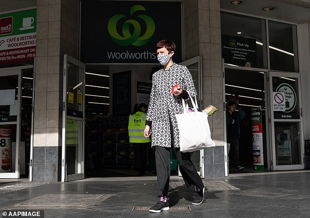 Mr Dunphy said pubs, clubs, bars, casinos, cafes and restaurants are all considered high-risk for transmission of the virus (pictured woman in face mask leaving Sydney Woolworths on Friday)