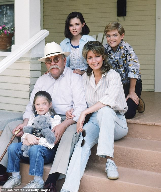 In 1986, Brimley played a grandfather who looked after the family of his late son on the NBC series Our House. Brimley is pictured above with the stars Shannen Doherty (top left); Chad Allen (top right); Deidre Hall (second row from right); and Keri Houlihan (bottom left)