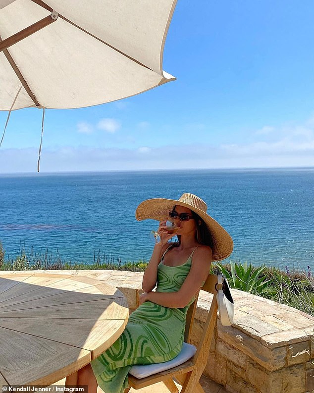Day in the life:When Kendall is not adding fuel to her romance rumors, she is busy hunkering down at her older sister Kourtney Kardashian's lavish beachfront rental property in Malibu; Kendall pictured on Instagram on July 25