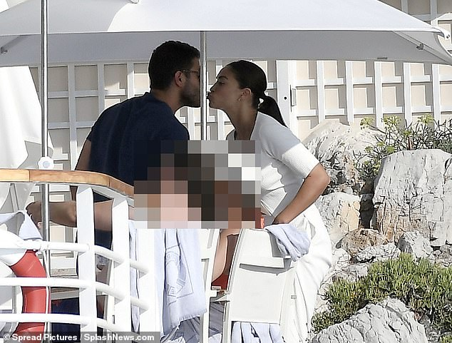 Honeymoon period: Shanina Shaik put on a loved up display with her beau Seyed Payam Mirtorabi at the Hotel du Cap Eden Roc in the South of France on Sunday
