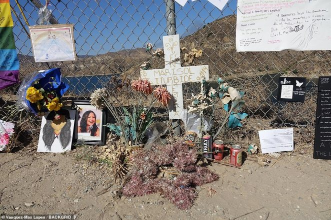 A pile of dried flowers is seen next to a photo of Rivera and a few drawings left by fans