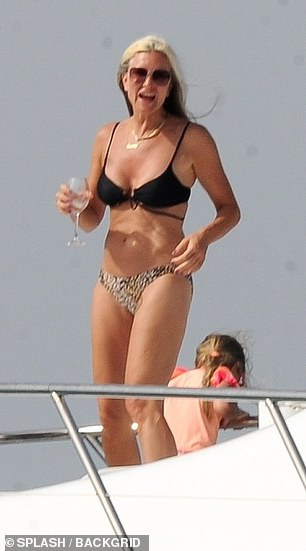 Wow-factor: The model stunned in a mismatched bikini as she and her gal pal knocked back wine on the Chill Out boat