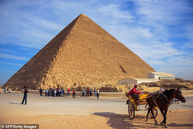 The CEO of electric vehicle maker Tesla, who also is founder of aeronautics firm SpaceX, gave credit to 'aliens' for building the pyramids in Giza (pictured) near Cairo in a tweet on Friday