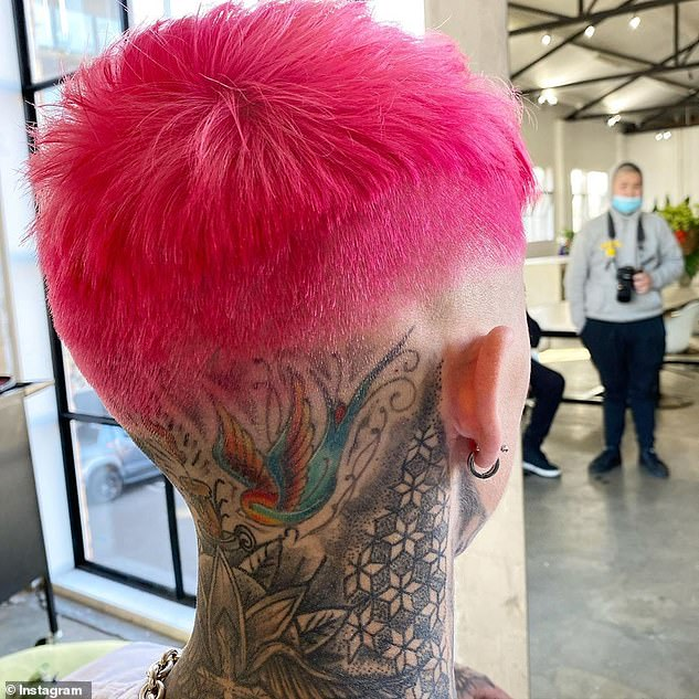Think pink: The eye-popping hairdo features a blunt fringe, which sits high on Ciarran's forehead, shaved sides, and a bald back, which frames his neck tattoos