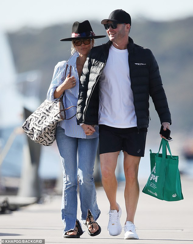 Love is in the air! Pip and Michael held hands as they strolled on the marina towards the boat