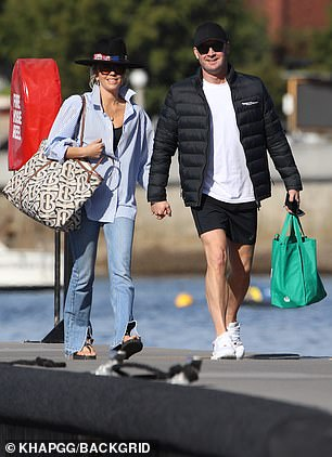 Love: Pip was all smiles as she held hands with Michael while strolling towards the boat