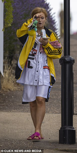 Colourful: The EastEnders actress opted for comfort in long white shorts and a matching sports top