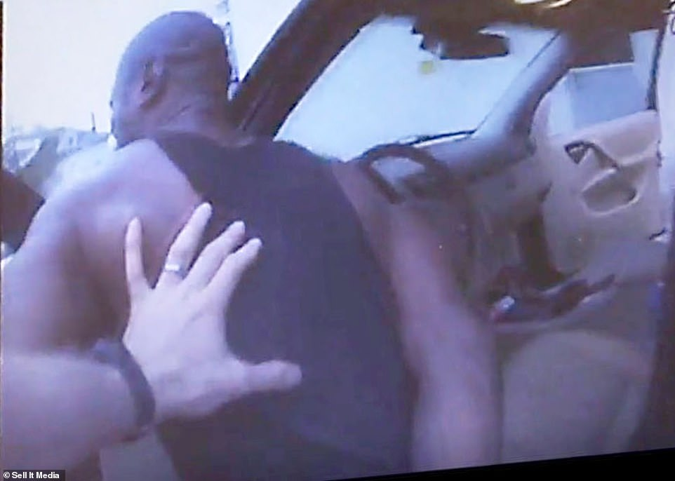 The cop then orders Floyd out of the car, saying: 'Hands on top of your head. Step out of the vehicle and step away from me.' That's when Floyd says: 'Okay. Mr. Officer, please don't shoot me. Please man.' 'I'm not going to shoot you,' Lane says. 'Step out and face away.' 'I'll look at you eye-to-eye. Please don't shoot me man,' Floyd replies. 'I just lost my mom, man'