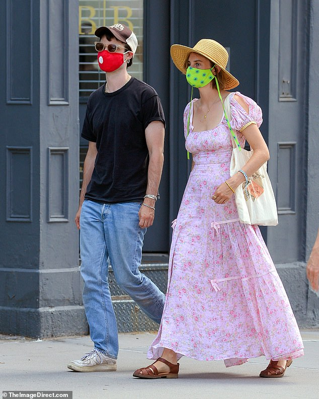 Cautious: The couple both donned colourful face masks, with Tom in red and Maya in a bright green mask