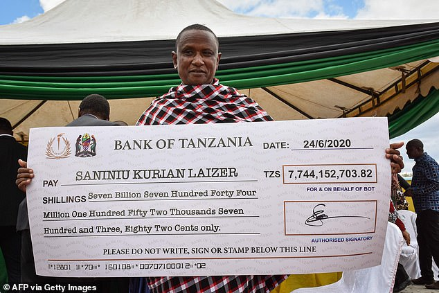 Last month, Laizer was pictured on Tanzanian television being presented with a large cheque, above, after the Bank of Tanzania bought the gemstones in a ceremony