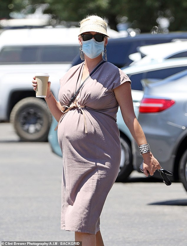Masked up: The expecting beauty made sure to keep safe and wear a mask