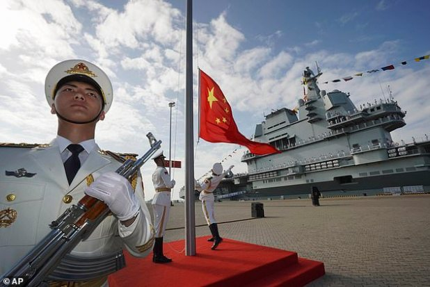 China accounts for 48.8 percent of Australia's exports and may reduce national dependence on communist bodies for international body trade.  Picture: A Chinese Navy member is standing in front of a Shandong aircraft carrier