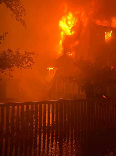 Fires burning inside homes on Ocean Isle Beach in North Carolina last night as Hurricane Isaia made landfall