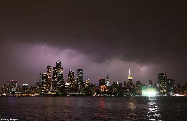 Lightning strikes as storms hit New York City on Monday. The image above was taken across the Hudson River in Hoboken, New Jersey, on Monday