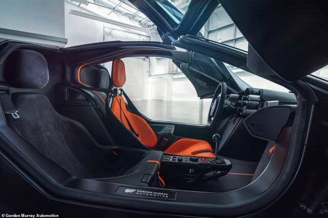 This image shows the incredible interior design, with the driver's orange seat flanked by two black passenger seats. Murray says the car is still no wider than a rival supercar as the passenger seats are close to the middle chair but position further back