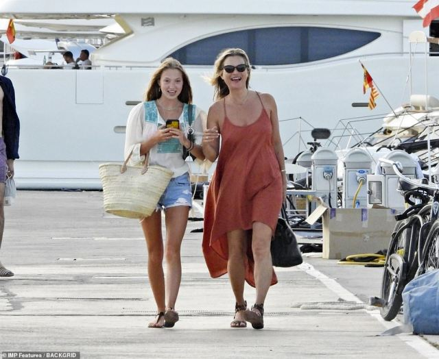 All aboard! The mother and daughter had arrived for their boat day looking equally chic with Kate wowing in a loose strappy red sun dress, while Lila Graceteamed denim shorts with a boho top