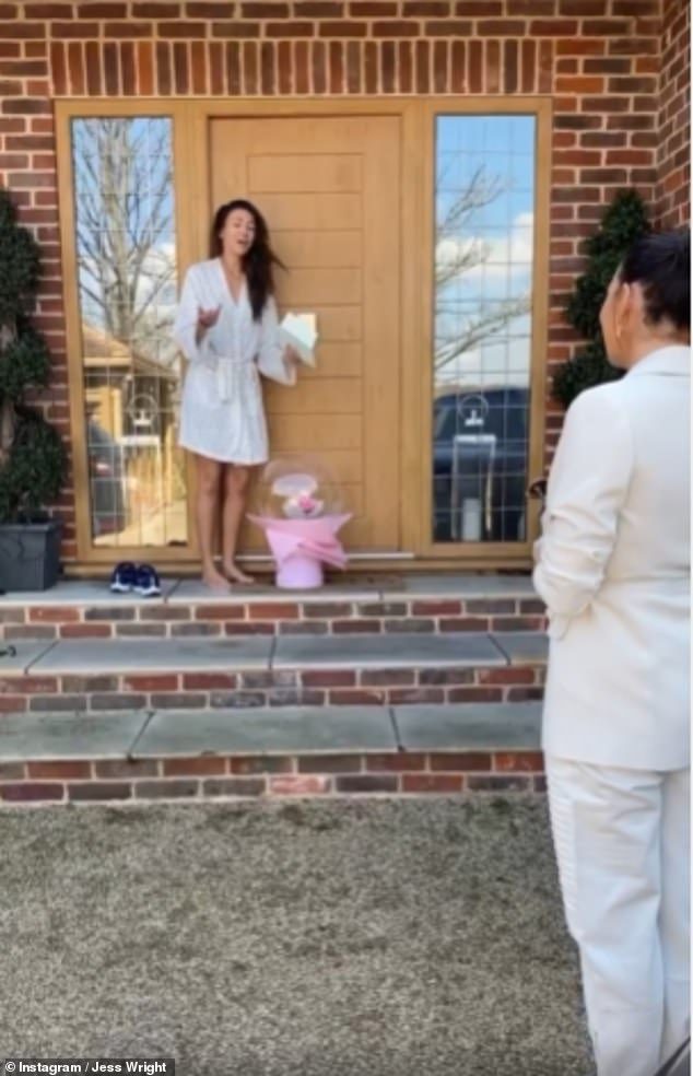 What a surprise:Actress Michelle, 33, was dressed in a satin robe as she gasped from her doorstep and admitted: 'I'm actually shaking!'