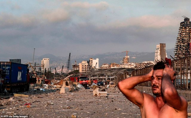 A man reacts at the scene of an explosion at the port in Lebanon's capital Beirut on August 4