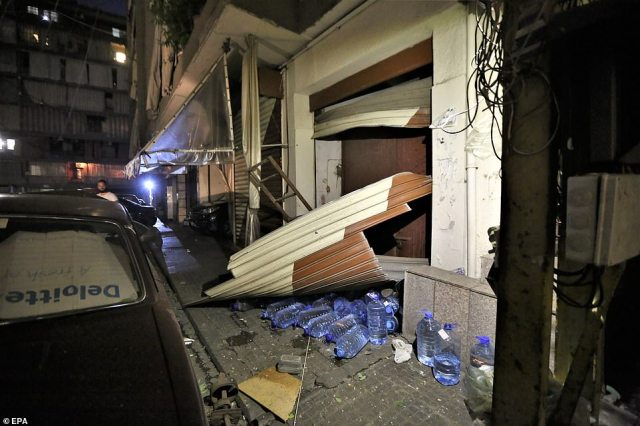 A view shows the damages entrance of a store in Burj Abu Haidar area in Beirut