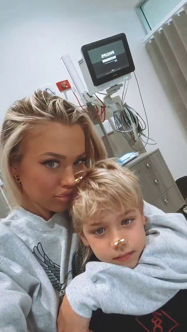 Careful there! Tammy Hembrow doted on lookalike son Wolf, five, on Wednesday as she rushed him to the hospital after an accident