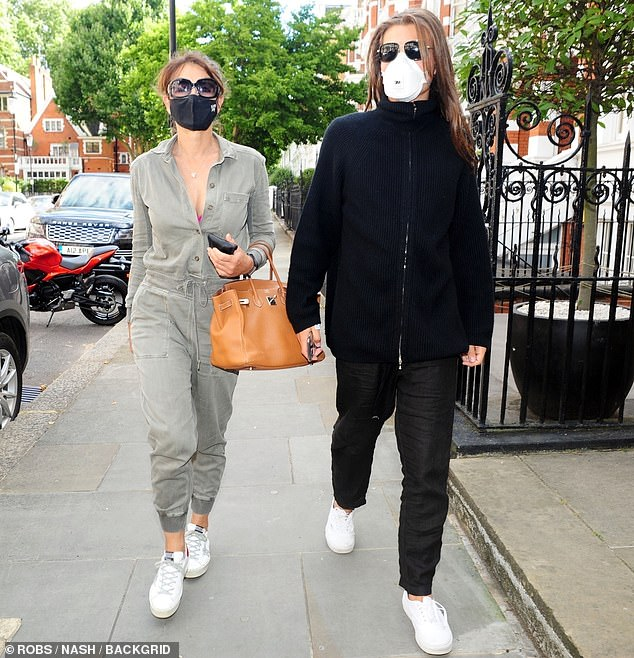 Family:Elizabeth Hurley, 55, and her son Damian, 18, stepped out together for the first time since the death of the teen's father Steve Bing in late June, aged 55
