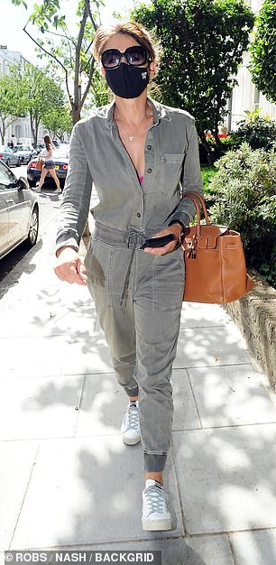 Looking good: Styling her brunette locks into an updo, Elizabeth completed her look for the day with a pair of sunglasses