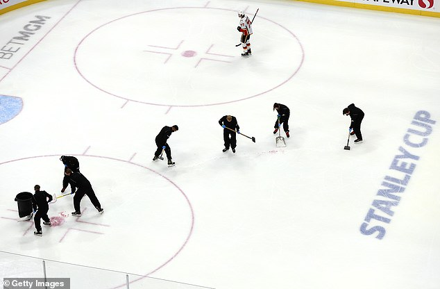 Edmonton's ice crew quickly scraped up the plasma at Rogers Place, which has banned fans amid the coronavirus pandemic