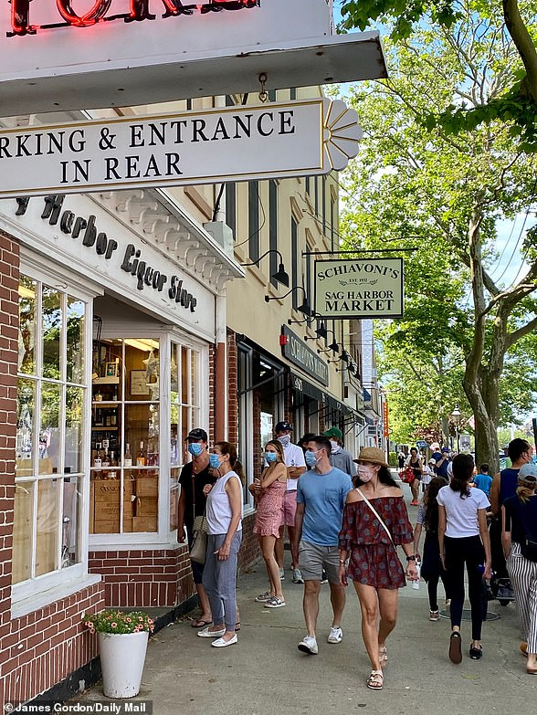 Meanwhile in the Hamptons, stores and restaurants are enjoying bustling trade from the well-heeled city dwellers who have fled there. Pictured, the village of Sag Harbor