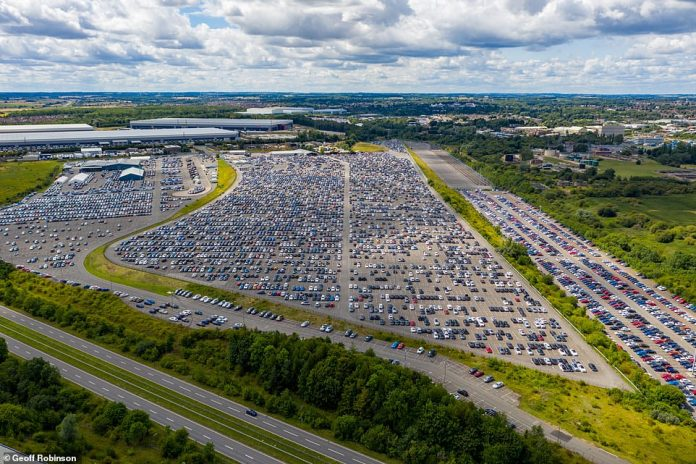 Thousands of cars are in storage in Corby, Northamptonshire, before delivery to dealers across the country