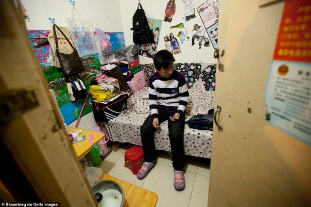 A man sits inside his apartment inside a Chinese air defense bunker in the outskirts of Beijing, China