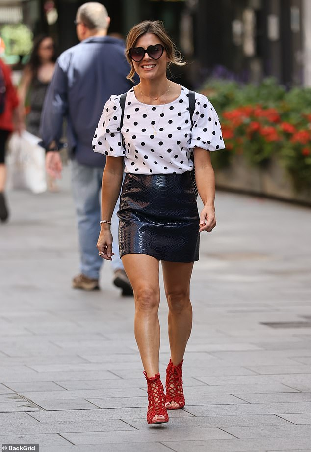 Stylish arrival:Zoe Hardman plastered on a smile as she arrived to work at Global Radio Studios in London on Wednesday