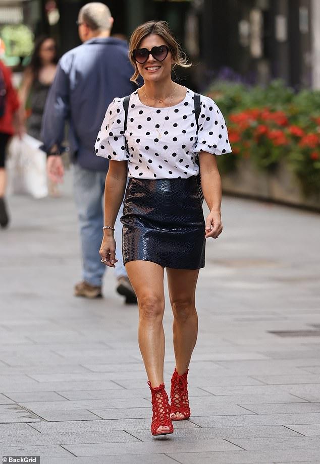 Zoe Hardman puts on a leggy display in a racy leather mini skirt as she arrives at Global studios