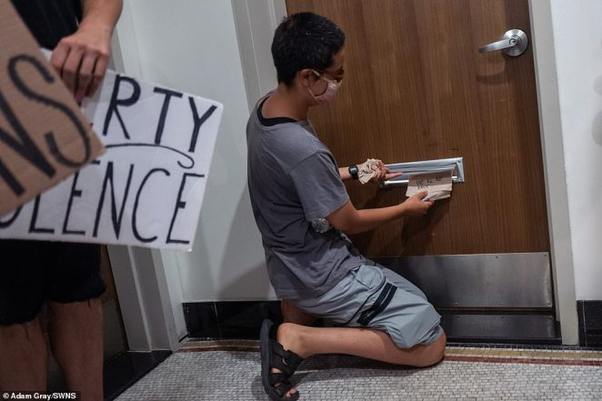 One protester leaves a note reading 'We'll be back' in the offices of real estate law firm Stern & Stern