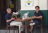 Michael McIntyre dons spiked GOLF shoes while dining al fresco with a pal