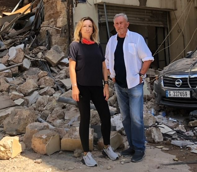 The fireball was like no other I've ever seen or felt before, and I have seen my fair share. At its centre, a huge, intense red ball of flame that spewed smoke, ash and debris high into Beirut's late afternoon sky. Pictured:Brent Sadler and wife Jelena in front of a devastated building