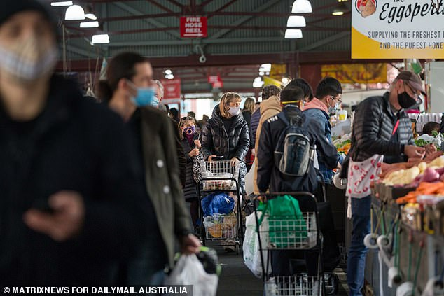 People packed Queen Victoria Market on day one of the full stage 4 lockdown