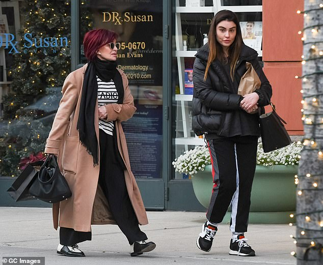 Aimee, pictured with mom Sharon in LA in January, has forged her own music career and is currently promoting her new single with band ARO called Shared Something With The Night