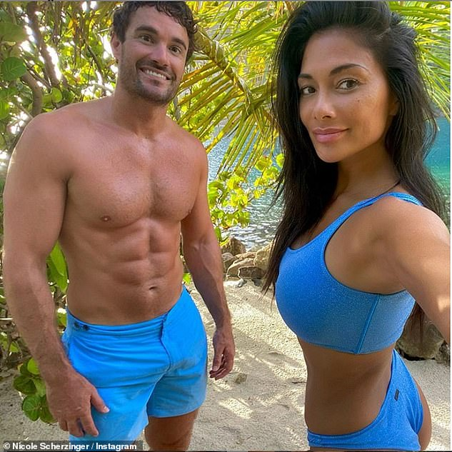 Loved up: The X Factor judge and her beau Thom, 35, are currently enjoying an extended break in sunny Portugal after flying out at the end of June to celebrate Nicole's 42nd birthday